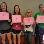 girls holding certificates