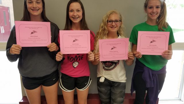 girls holding certificates