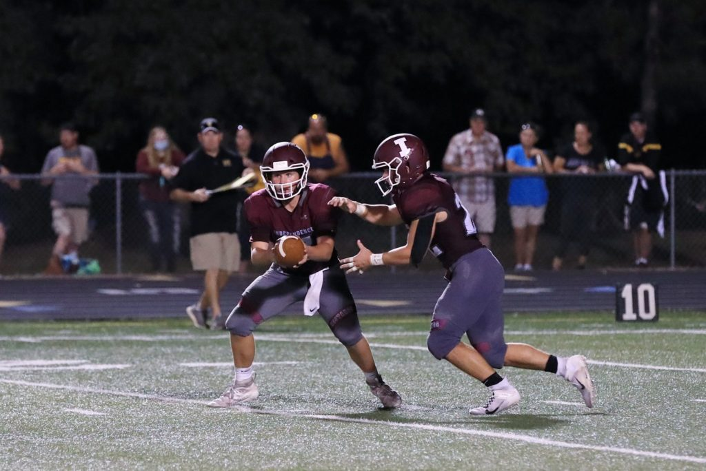 Quarterback executes a handoff