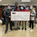 Cy and Charleys presents check donation to Mustang Way Park campaign