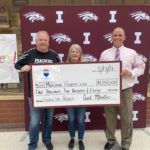 Curt Martin, Deb Martin, and Dewey Hupke holding a check