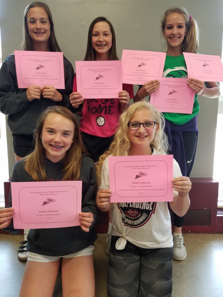 girls track record breakers holding certificates