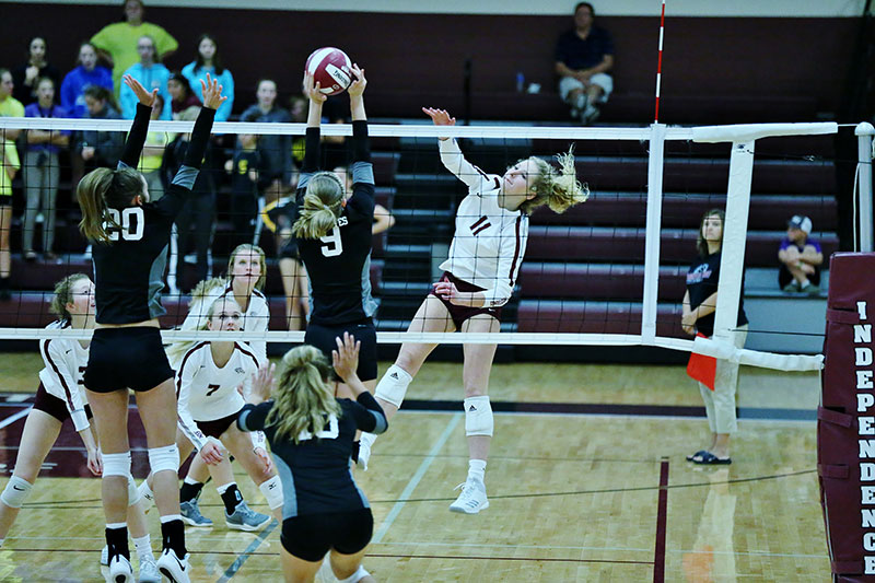 larson spiking the volleyball